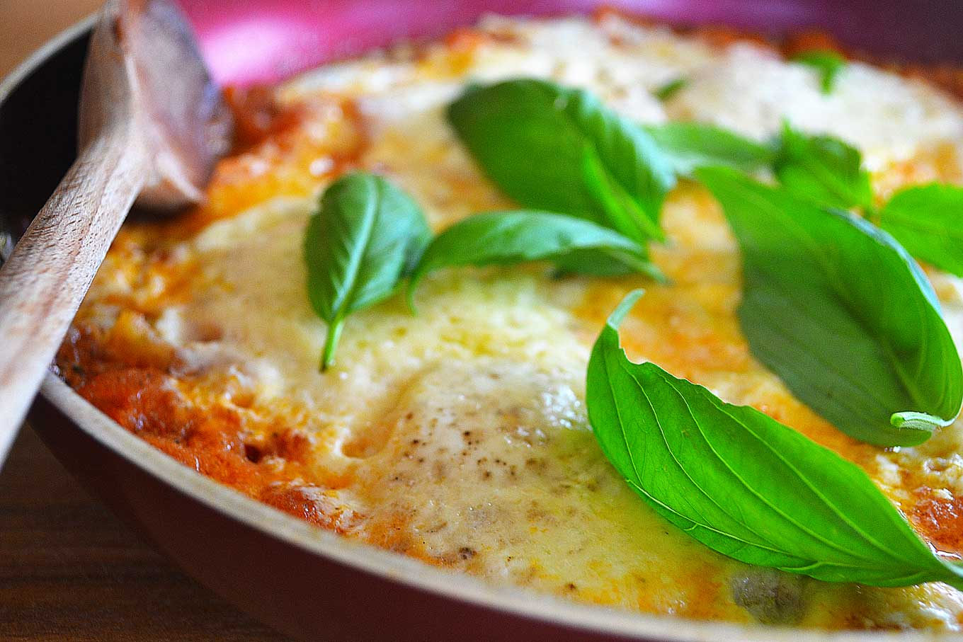 skillet eggs with tomatoes, parmigiano-reggiano & basil | rusticplate.com