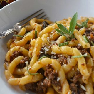 busiate pasta with tomato hued wild boar sausage | rusticplate.come.com